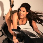 140812-Kelly-Brook-Bent-Over-on-Motorcycle-Boobs-Hanging